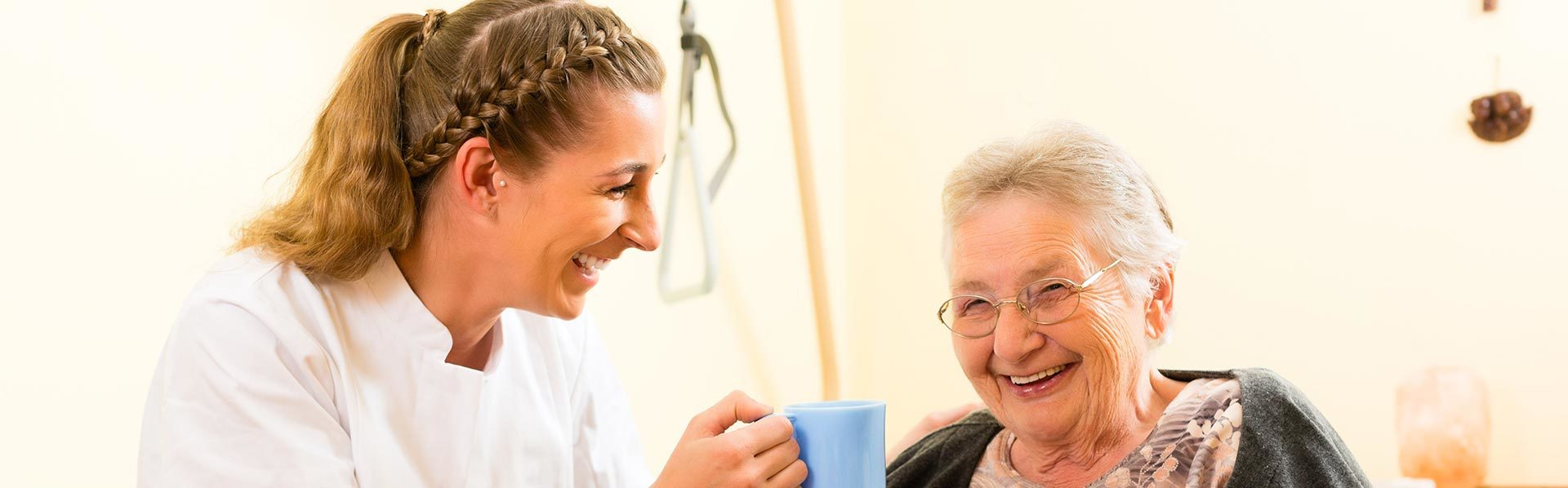 Smiling caregiver with senior